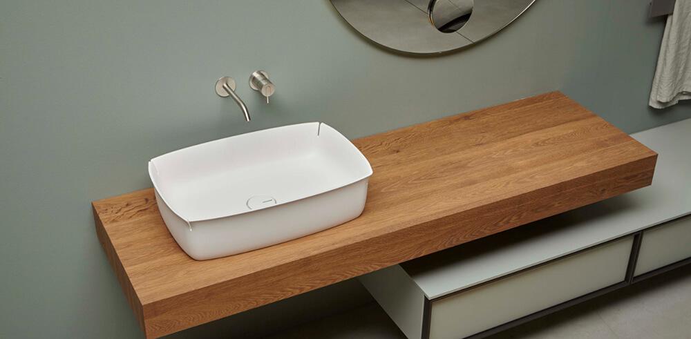 Bloom de Antonio Lupi, el lavabo con cuatro suaves fisuras fabricado con flumood