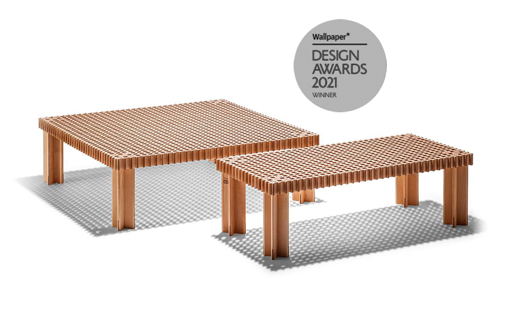 mesa axiliar de diseño Poltrona Frau fabricación artesanal